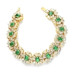 "7"" long Diamond Essence Bracelet with Emerald cut 13 Emerald Essence,each 1ct, surrounded by Marquie, Pear and Round stones. Appx. 38.0 Cts. T.W. set in 14K Solid Yellow Gold."