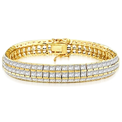 Lovely best selling bracelet with 23.25 cts.t.w. of square Ruby Essence and white princess cut stones in 14K Yellow Gold.