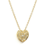 Beautiful Heart Pendant with the outer ring of heart encircling the micro pave set bulge heart. Truly lovable. 2 Cts. T.W. set in 14K Solid Yellow Gold.