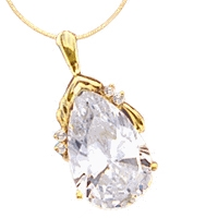 14K Solid Yellow Gold Pendant, 18 Carats T.W., with Pear Cut jewel and four Melee accents.The Pear cut stone is 22x44mm. In the back the bail has a snap on so that it can be worn as Pearl Enhancer on a Pearl Necklace.
