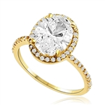Beautiful Oval Centerpiece, 2.5 cts, is surrounded by Round Brilliant Melee in this elegant engagement ring. The band consists of round pointer melee to form a brilliant radiance. Appx. 3.5 Ct. T.W. In 14k Solid Yellow Gold.