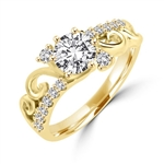 Artistic design in delicate setting with 0.75 Ct. Round Brilliant Diamond Essence stone set in six prongs. 0.20 Ct. each, Round stone in cross setting and round melee dramatically set in 14K Solid Gold. 2.75 Cts.T.W.