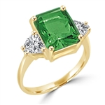ring with 5 ct emerald stone and trilliant baguettes