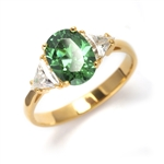 Stunning Ring, 2 Cts. T.W, with 1 Ct Oval Cut Emerald Center  and White Trilliant Diamond Essence Stones on side, in 14K Solid Yellow Gold.