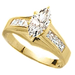 Diamond Essence Ring With 0.75 Ct. Marquise Center Followed By Channel Set Princess Stone Enhance the look Of Band In 14K Yellow Gold, 1.50 Cts.T.W.