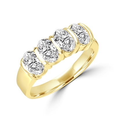 Mesmerizing Band that is artfully decorated with four matching Oval Cut Diamond Essence Masterpieces. 2 Cts. T.W. in 14K Solid Gold.