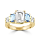 Classic Wide Ring with a 2 Ct. Emerald Cut Brilliant Masterpiece in the center, saluted on each side by a 0.5 ct. Emerald Cut Aquamarine Stone and clear white Baguette Masterpieces further down. 3.5 Cts. T.W, in 14K Solid Gold.