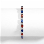 "Perfect party wear. 7"" long Diamond essence Platinum Plated Sterling Silver bracelet, in alternate setting of oval cut Sapphire Essence and Garnet Essence stones, 0.5 carat each in four prongs. Diamond Essence melee set in between for more dramatic look."