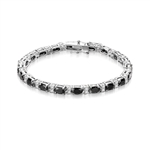 "Perfect Party wear. 7"" long Diamond Essence Platinum Plated Sterling Silver bracelet with Oval cut Onyx Essence, 0.5 Ct.  each set in four prongs and Diamond Essence Melee set in between for more dramatic look. 10.0 Cts.T.W."