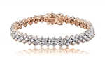 "Diamond Essence 7"" long dazzling bracelet. Round brilliant stones, 0.7 ct. each, set in four prong setting of Rose Plated Sterling Silver. 3 rows, 7 mm width, 8.5 cts.t.w. gives brilliant sparkle and just perfect party wear."