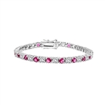 Diamond Essence tennis bracelet of round brilliant and pink sapphire stones, 0.20 ct. each set alternate in Platinum Plated Sterling Silver. 7.75 cts.t.w.