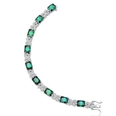 "A stunner, this Platinum Plated Sterling Silver 7"" bracelet features nine radiant-cut Emerald stones, 3.0 cts each, joined by stylish ribbons of melee. 29.0 cts. T.W."