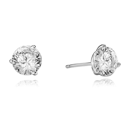 Pair of Studs in three prongs Martini Setting, Round Diamond Essence in each stud. 1.0 Ct T.W. set in Platinum Plated Sterling Silver.
