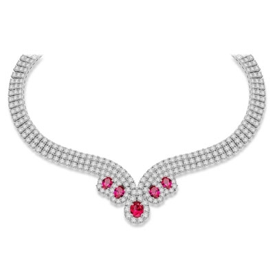 Magnificent Ruby Necklace. 3.0 Cts. Oval cut Ruby Essence in the center and 1.50 Cts. each Ruby Essence encircled by Diamond Essence stones. making 3 rows all around neckline. Special lock- on clasp to secure it. Just perfect to make any day a special day