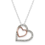 Diamond Essence Two-Tone Heart In Heart Pendant With Beautifully Channel Set Round Brilliant Stones, 1 Ct.T.W. In Platinum Plated Sterling Silver.
