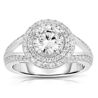 Diamond Essence Designer Ring with 1.25 carat Round Essence in center, surrounded by Round Essence melee in two rows around and two delicate rows on the band for more elegance. Appx. 2.50 Cts. T.W. set in Platinum Plated Sterling Silver.