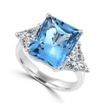 Diamond Essence Aquamarine stone of 5.0 cts. setting with trilliant baguette on each side. 5.75 cts.T.W. set in Platinum Plated Sterling Silver.