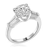 Platinum Plated Sterling Silver Diamond Essence engagement ring. 2.0 ct.round brilliant stones and delicate baguette on each side. 2.50 cts.t.w. Perfect for the occassion.