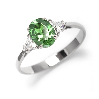 Stunning Ring, 2 Cts. T.W, with 1 Ct Oval Cut Emerald Center  and White Trilliant Diamond Essence Stones on side, in Platinum Plated Sterling Silver.