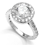 Diamond Essence Halo Setting Designer Ring With 2 Cts. Round Center and Melee around And On The Band, 4.50 Cts.T.W. In Platinum Plated Sterling Silver.