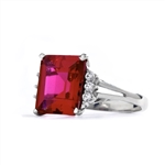 Superb Ring with 5 Cts Emerald Cut Ruby Essence Center Stone and melee accents for a total of 5.2 Cts.t.w. in  Platinum Plated Sterling Silver.