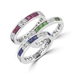 Best selling Eternity Bands with Princess Cut simulated Emeralds and Round Cut Diamond Essence stones all around the band. 1.5 Cts. T.W, in Platinum Plated Sterling Silver.