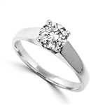 Smart Solitaire Ring with 0.75 Cts. Round Brilliant Masterpiece set perfectly on a tapering wide band. In Platinum Plated Sterling Silver.