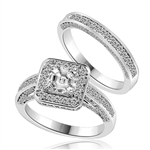 Wedding set with sparkles all around-1.0 ct.Princess cut Diamond Essence set in the center, outlined with Melee around and on the band. Curved matching band with sparkling melee. 1.75 cts.t.w. in Platinum Plated Sterling Set.