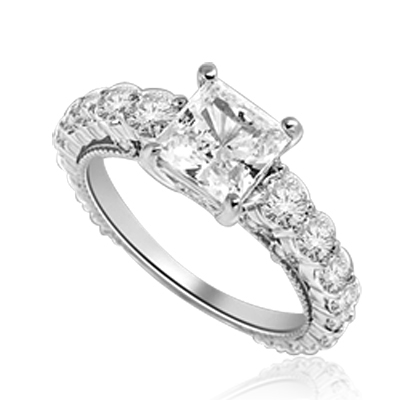 Engagement Ring With Princess Cut Diamond Essence Set in Center accompanied by Round Brilliant Diamond Essence going down the band. 3.25 Cts. T.W. set in Platinum Plated Sterling Silver.
