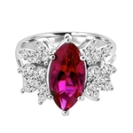 Designer Ring with 2.0 Cts. Marquise cut Ruby Essence in center accompanied by delicately set Marquise and Melee on each side. 3.0 Cts. T. W. set in Platinum Plated Sterling Silver.