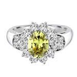 Floral Ring - 1.25 Cts. Oval cut Peridot Essence set in center with Round brilliant Diamond Essence on top and bottom and cluster of Melee, making floral design, on either side of band. 2.0 Cts. T.W. set in Platinum Plated Sterling Silver.