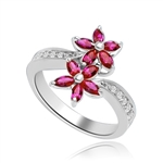 Dual Flowers - Curvy Band shines bright and Ruby Oval Flower Cluster sits pretty in this unique design. 2 Ct. T.W. In Platinum Plated Sterling Silver.