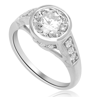 Bezel Set Ring Boasts of 2 Ct Round Solitaire in a unique contemporary band with round accent melee. A sheer beauty! 3 Cts. T.W. In Platinum Plated Sterling Silver.