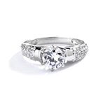 Engagement Ring- Tiffany set, 1.0 Ct Round Brilliant Diamond Essence in center with cluster of sparkling Melee on the band. 1.25 Cts T.W. set in Platinum Plated Sterling Silver.