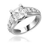 Brilliantly crafted Diamond Essence Princess cut masterpiece is flanked by graduating Princess cut stones on the band exquisitely set in channel setting boasting 3 Cts. T.W. In Platinum Plated Sterling Silver. Available in select Ring sizes.