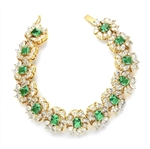 "7"" long Diamond Essence Bracelet with Emerald cut 13 Emerald Essence,each 1ct, surrounded by Marquie, Pear and Round stones. Appx. 38.0 Cts. T.W. set in 14K Gold Vermeil."