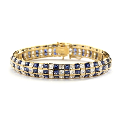 "7""Lovely best selling bracelet with 23.25 Cts. T.W. of square Sapphire Essence and white princess cut stones set in 14K Gold Vermeil."