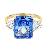 Diamond Essence Aquamarine stone of 5.0 cts. setting with trilliant baguette on each side. 5.75 cts.T.W. set in 14K Gold Vermeil.