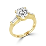 Diamond Essence engagement ring in 14k Gold Vermeil with 2.0 ct.round brilliant stones and delicate baguette on each side. 2.50 cts.t.w. Perfect for the occassion.