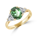 Stunning Ring, 2 Cts. T.W, with 1 Ct Oval Cut Emerald Center  and White Trilliant Diamond Essence Stones on side, in Gold Vermeil.