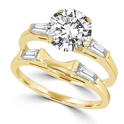 Ring – round stones and baguettes with 'c' curve ring
