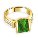 Sarabande - Impressive Ring with 4 Ct. Emerald Cut Emerald Essence Center and featuring Channel Set accents on the band. 5 Cts. T.W.