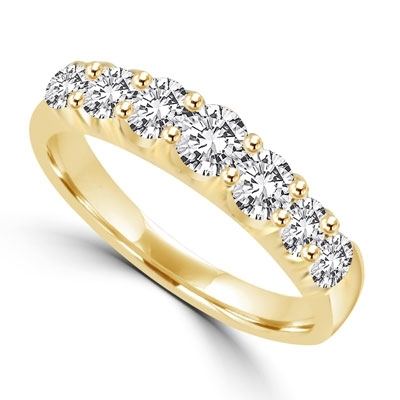 14K Gold Vermeil ring of 1.0 ct.t.w. graduated round briliant Diamond Essence stones. Perfect for all the occassions. (Also available in 14K Solid Gold, Item#<a href='product_p/grd138.htm'>GRD138</a>).