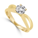 This Ring Is a sureshot hit with jewelry conossieurs. 0.75 Ct. Round Brilliant Masterpiece is set exquisitely on a cross curve band. In 14k Gold Vermeil.