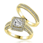 Wedding set with sparkles all around-1.0 ct.Princess cut Diamond Essence set in the center, outlined with Melee around and on the band. Curved matching band with sparkling melee. 1.75 cts.t.w. in Gold Vermeil.