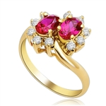 Two Ruby Oval Essence, 0.5 ct. each, set in four prongs and surrounded by melee to give floral effect. 1.20 cts. t.w. In 14k Gold Vermeil.
