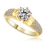 Engagement Ring- Tiffany set, 1.0 Ct Round Brilliant Diamond Essence in center with cluster of sparkling Melee on the band. 1.25 Cts T.W. set in 14K Gold Vermeil.