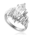 Bamboo ring. An unusually beautiful ring with spikes of 14k Solid White gold surrounding a dazzling  3.0 carat marquise cut Diamond Essence.