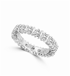 eternity band with alternate bar and round stone in white gold ring