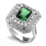 Diamond Essence Cocktail Ring With 2.50 Cts. Emerald Essence Radiant Emerald In Center Round Melee Around It, 4.50 Cts.T.W. In 14K White Gold.
